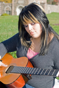 Girl Playing a Guitar