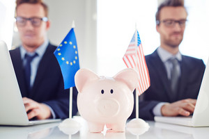 Piggy Bank Between Eu And American Flag With Two Business Partners On Background
