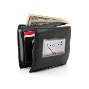 A black leather wallet with only two dollars left has a gauge on it with the needle pointing to E for empty.