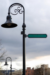 A blank street sign and lamp post with copyspace ready for your text.