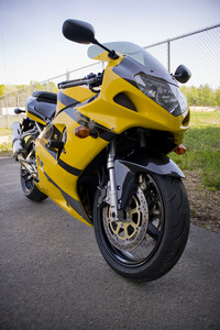 A brand new yellow motorcycle - modern day crotch rocket.