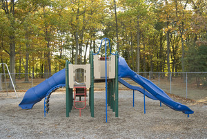 A brightly colored play scape at the park. A fun place to be when you're a kid!