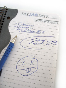 A busy daily schedule book of a modern mom or dad.