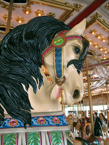 A closeup of a merry go round horse.
