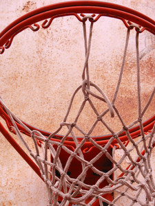 A closeup of a playground basketball goal and net.