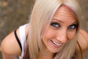 A closeup of a pretty blond woman from a higher angle.