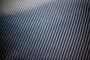 A closeup of real carbon fiber material.  This makes an excellent texture or background.  Shallow depth of field.