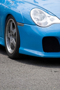 A closeup of the custom rims and widebody kit on a modern sports car with plenty of copyspace.