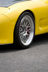 A closeup of the custom rims on a modern sports car with plenty of copyspace.