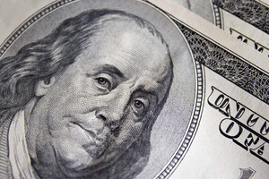 A closeup of the new 100 dollar bill picturing Benjamin Franklin.  It's all about the Benjamins.