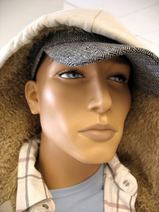 A closeup shot of the face on a trendy male mannequin.