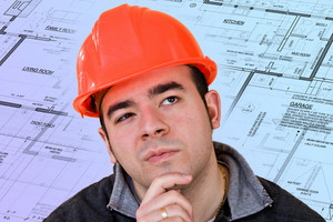 A construction worker or architect wearing a hard hat has a contemplative look on his face with generic blueprints in the background.