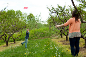 A couple plays with a frisbee together outdoors.