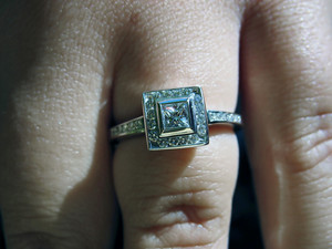 A custom princess cut diamond engagement ring