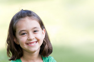 A cute little girl smiling happily with copyspace.