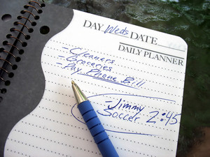 A daily planner filled with a busy parent's daily activities.