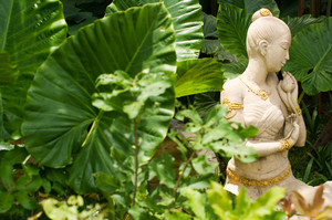 A female sculpture in a garden
