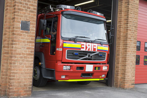 A fire engine leaving the fire station
