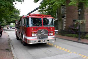 A fire engine speeding down the road.  Intentional motion blur panning effect.
