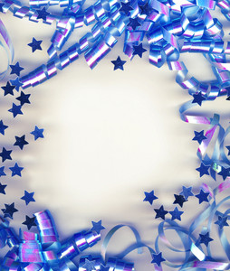 A Frame Made Of Colorful Blue Vintage Streamer On White Background