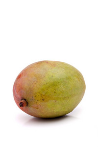 A fresh whole mango fruit isolated over white.