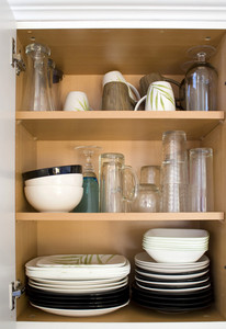 A full cabinet full of dishes and plates.