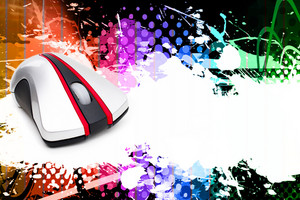 A funky and rainbow colored splatter layout with a computer mouse and plenty of copy space.