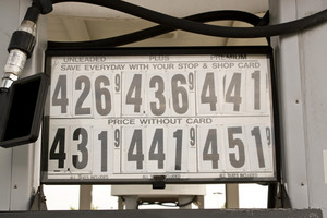A gas station sign showing the ever rising fuel costs.