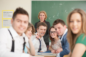 A group of cheerful students sitting in a classrom
