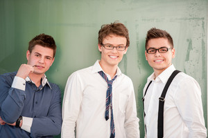 A group of male students standing on a chalkboard