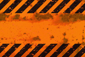 A grungy and worn hazard stripes texture.