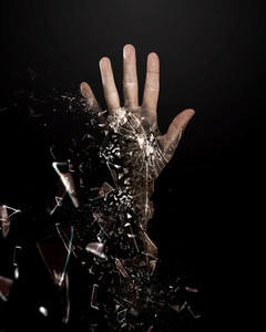 A hand is broken into many pieces
