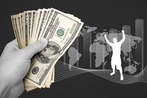 A handful of cash isolated over a business finance themed background.