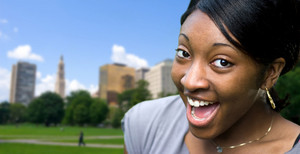 A happy or surprised young black woman posing in Hartford Connecticut.