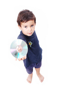 A little boy is holding cd in his hand