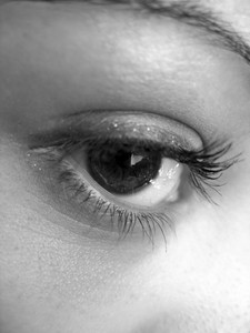 A macro shot of a pretty eye in black and white.