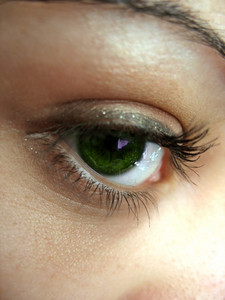 A macro shot of a pretty green eye and lashes - shallow depth of field.