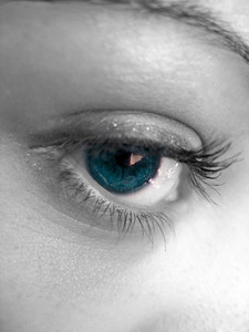 A macro shot of a pretty woman's eye with selective color.