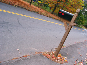 "A mailbox near the road with some nice fall foliage in the background.  When I shot this I tried to use a nice, ""creative tilt""."
