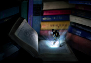 A man digs a hole into the Bible and light pours out.
