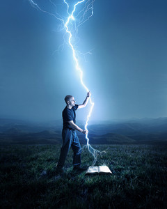 A man holds a streak of lightning as it goes into the Bible.