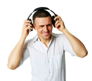 A man not enjoying what he is hearing