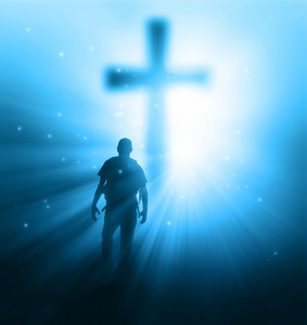 A man walking towards a cross with sunbeams