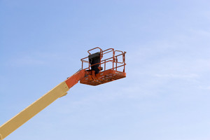 A modern cherry picker or lift for use in commercial construction or painting.