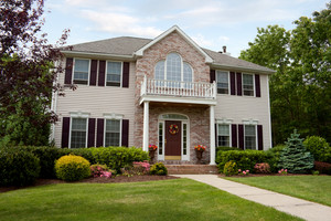 A modern custom built luxury home in a residential neighborhood.  This upper class home is a very nicely landscaped property.