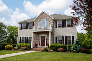 A modern custom built luxury house in a residential neighborhood.  This high end home is very nicely landscaped property.