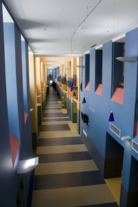 A modern interior with a long empty hallway with contemporary design.