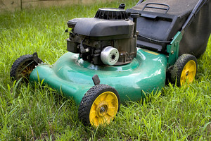 A modern lawn mower cutting through the grass.