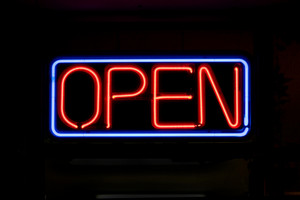 A neon OPEN sign commonly seen in businesses.