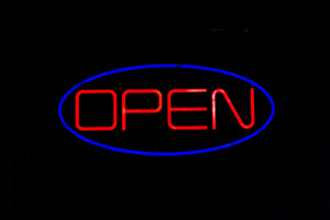 A neon OPEN sign isolated over black.